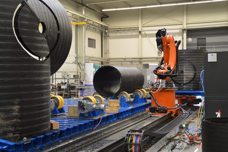 Installation of a robotized RFA machining centre for high-volume plastic pipes